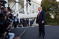 US President Donald J. Trump stops to deliver remarks to the news media as he walks to board Marine One on the South Lawn of the White House in Washington, DC, USA, 07 October 2017. President Trump is traveling to  North Carolina for a pair of fund raising events<br /> CAP/MPI/POOL/ST<br /> &copy;ST/POOL/MPI/Capital Pictures