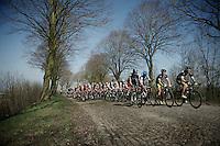 peloton up Casselberg..74th Gent-Wevelgem (2012).236km between Deinze & Wevelgem.winner 2012: Tom Boonen..