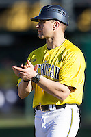 Michigan Wolverines head coach Erik Bakich (23) during the NCAA season opening baseball game against the Texas State Bobcats on February 14, 2014 at Bobcat Ballpark in San Marcos, Texas. Texas State defeated Michigan 8-7 in 10 innings. (Andrew Woolley/Four Seam Images)
