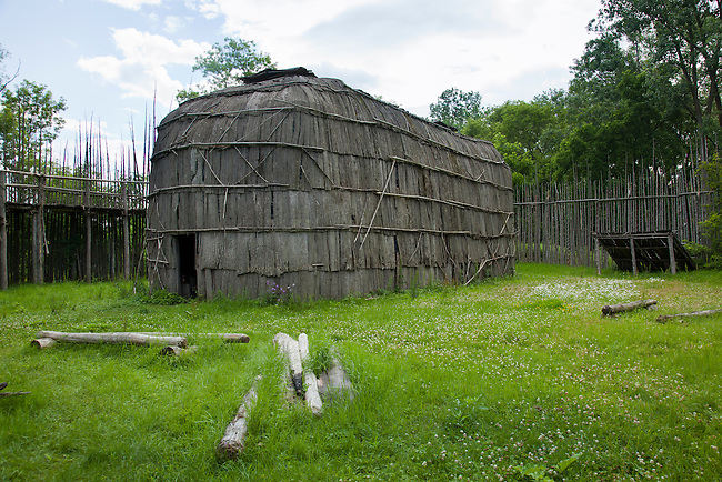 Traditional Iroquois longhouse and palisades fence located in the ancient village of Kanata on the Six Nations of the Grand River Reservation, Ohsweken Ontario Canada