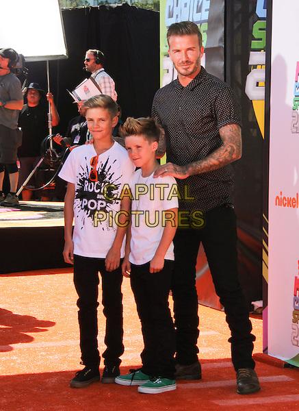 LOS ANGELES, CA - JULY 17: David Beckham, Romeo James Beckham, and Cruz David Beckham at Nickelodeon Kids' Choice Sports Awards 2014 at Pauley Pavilion on July 17, 2014 in Los Angeles, California. <br /> CAP/MPI/MPI99<br /> &copy;MPI99/ MediaPunch/Capital Pictures