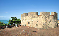Crenelated tower and cannons at the Fortaleza San Felipe, or El Morro de San Felipe, a defensive fortress built 1564-77 to protect Puerto Plata from pirates, in Puerto Plata province, Dominican Republic, in the Caribbean. In 1983 the Museo de la Fortaleza San Felipe was opened here, containing military artefacts from the fort's history. Picture by Manuel Cohen