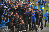 Tommy Fleetwood (Team Europe) celebrates with the groundskeepers following Sunday's singles of the 2018 Ryder Cup, Le Golf National, Guyancourt, France. 9/30/2018.<br /> Picture: Golffile | Ken Murray<br /> <br /> <br /> All photo usage must carry mandatory copyright credit (© Golffile | Ken Murray)