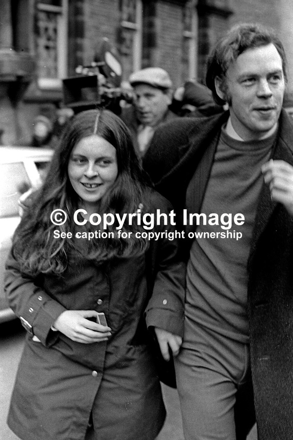 Civil rights activist &amp; Unity MP for Mid-Ulster, Bernadette Devlin, is hustled away from a Belfast Court after being sentenced to 6 months jail for taking part in an illegal march on the M1 Motorway in N Ireland on Christmas Day 1971. 197202000072<br />