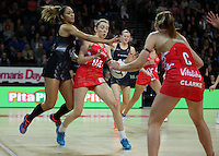 27.08.2016 Silver Ferns Phoenix Karaka and England's Helen Housby in action during the Netball Quad Series match between teh Silver Ferns and England at Vector Arena in Auckland. Mandatory Photo Credit ©Michael Bradley.