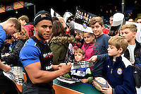Kyle Eastmond of Bath Rugby mingles and signs autographs with supporters at the end of the session. Bath Rugby Captain's Run on October 30, 2015 at the Recreation Ground in Bath, England. Photo by: Patrick Khachfe / Onside Images