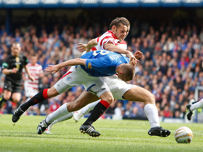 Kenny Miller sent sprawling in the box by Martin Canning but no penalty awarded