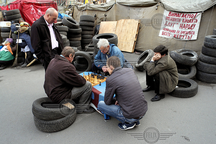 Men play chess in the middle of the protest camp on the Maidan.