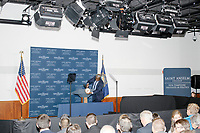 A man hangs the seal of the Vice President of the United States on a podium as people wait for Vice President Mike Pence to speak at a Politics and Eggs event at Saint Anselm College's Institute of Politics in Manchester, New Hampshire, on Thu., November 7, 2019. Pence traveled to New Hampshire as a surrogate for Donald Trump to file required paperwork for the president to get on the New Hampshire presidential primary ballot in 2020.