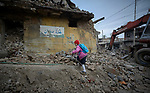 A girl makes her way to school amid the rubble of the Old City of Mosul, Iraq, which was devastated during the 2017 Battle of Mosul, which led to the defeat of the Islamic State group, also known as ISIS. During control of the city by the Islamic State, most children didn't attend school.