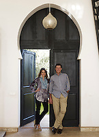 Maryam Montague and Chris Redecke at the entrance to their home in Marrakech