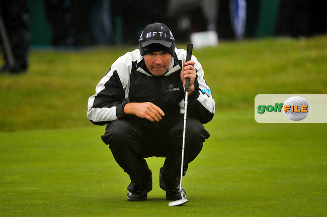 Padraig Harrington lines up his putt the 18th green during Round 2 of the 3 Irish Open on 15th May 2009 (Photo by Eoin Clarke/GOLFFILE)