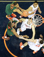 Virginia forward/center Mike Tobey (10) looks for the rebound during an NCAA basketball game Saturday Feb, 24, 2014 in Charlottesville, VA. Virginia defeated Miami 65-40.