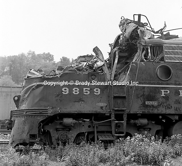 Corliss PA - View of a damaged locomotive at an accident site near the train station at Corliss Pennsylvania.  The assignment was for the PA Railroad due to a train derailment near the station - 1964.  Brady Stewart Studio was a contract photography studio for the railroad from 1955 through 1965.