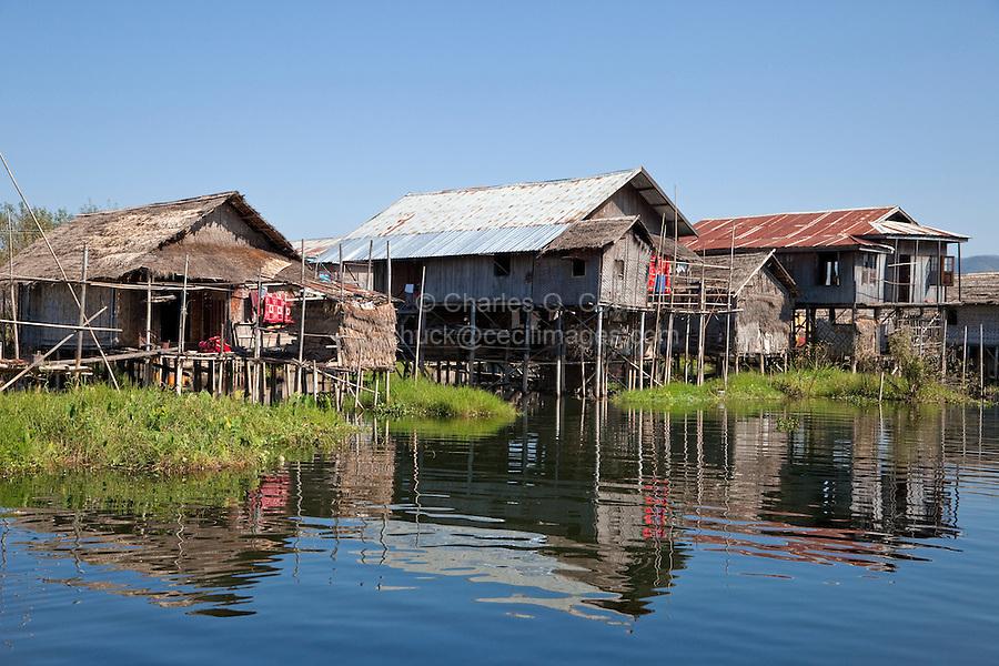 Myanmar, Burma.  Village Houses on Stilts, Inle Lake, Shan State.