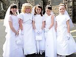 Kira O'Leary, Rosie Harrison, Kate Dennis, Aine O'Brien and Isobella Davis from Scoil Mhuire Fatima who made their First Holy Communion in St Mary's church. Photo: Colin Bell/pressphotos.ie