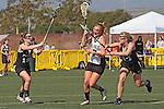 Santa Barbara, CA 02/18/12 - Molly Carstensen (Colorado #14), Taylor Haverty (Colorado #3) and unidentified Colorado player(s) in action during the 2012 Santa Barbara Shootout.  Colorado defeated Cal Poly SLO 8-7.