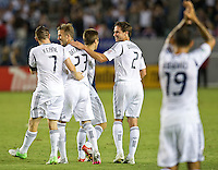 CARSON, CA - September 1, 2012:  LA Galaxy teammates congratulate David Beckham (23) on his goal during the LA Galaxy vs the Vancouver Whitecaps FC at the Home Depot Center in Carson, California. Final score LA Galaxy 1, Vancouver Whitecaps FC 0.