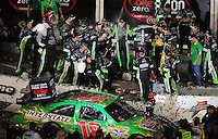 Jul. 5, 2008; Daytona Beach, FL, USA; NASCAR Sprint Cup Series driver Kyle Busch (center) raises his hands as his crew members spray him with champagne after winning the Coke Zero 400 at Daytona International Speedway. Mandatory Credit: Mark J. Rebilas-