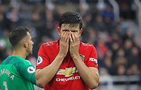 Harry Maguire of Man Utd covers his face during the Premier League match between Newcastle United and Manchester United at St. James's Park, Newcastle, England on 6 October 2019. Photo by J GILL / PRiME Media Images.