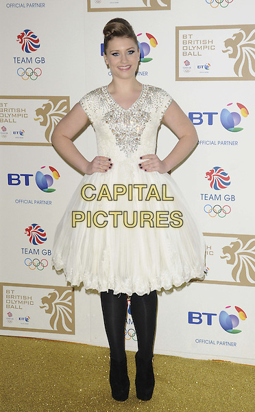 Ella Henderson.attended the BT British Olympic Ball, Grosvenor House Hotel, Park Lane, London, England, 30th November 2012..full length white silver beaded dress side hands on hips black tights shoes sparkly shoes platform  .CAP/CAN.©Can Nguyen/Capital Pictures.