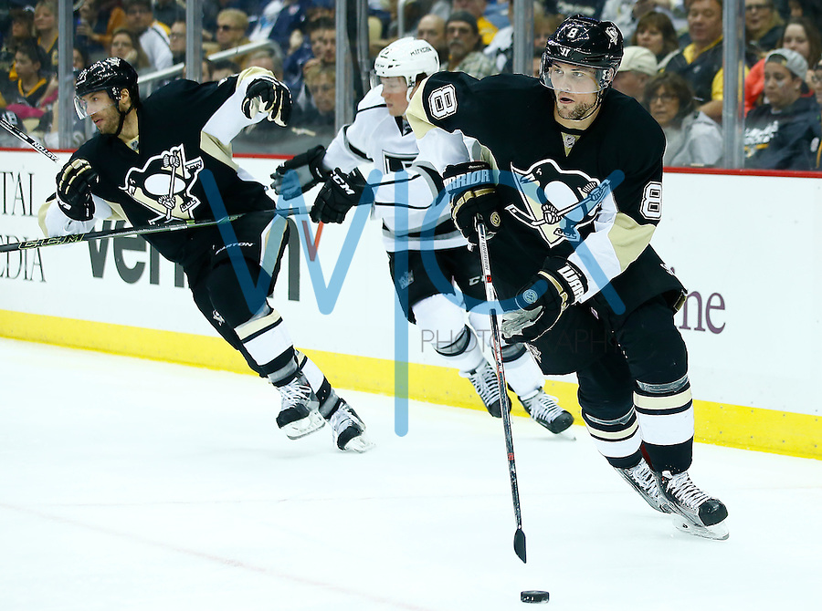 Brian Dumoulin #8 of the Pittsburgh Penguins in action against the Los Angeles Kings during the game at Consol Energy Center in Pittsburgh, Pennsylvania on December 11, 2015. (Photo by Jared Wickerham / DKPS)
