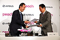 November 18, 2016, Tokyo, Japan - European aircraft giant Airbus CEO Fabris Bregier and Japan's budget airline Peach Aviation  CEO Shinichi Inoue exchange documents on Peach will buy 13 aircrafts of Airbus A320 at a press conference in Tokyo on Friday, November 18, 2016. Peach will purchase 3 A320 ceo aircrafts in 2018 and will receive the first A320 neo in 2019 from the Airbus.   (Photo by Yoshio Tsunoda/AFLO) LWX -ytd-