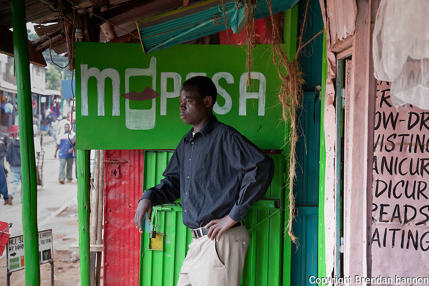 "Washington Akongo, 25, opened his mobile money transfer agency in Nairobo's Kibera slum four weeks ago. In the evenings, he's studying for his accountancy exams. ""I dream of being a CEO of Kenya's biggest banks,"" he says."