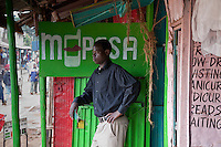 """Washington Akongo, 25, opened his mobile money transfer agency in Nairobo's Kibera slum four weeks ago. In the evenings, he's studying for his accountancy exams. """"I dream of being a CEO of Kenya's biggest banks,"""" he says."""