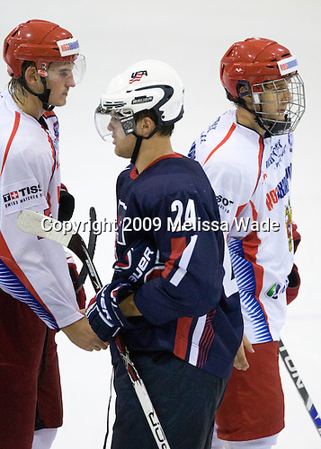 Georgy Guryanov (Russia - 15), Zach Budish (US - 24), Georgy Berdyukov (Russia - 21) - Team USA defeated Team Russia 6-1 in their second game during the 2009 USA Hockey National Junior Evaluation Camp on Wednesday, August 12, 2009, in the USA (NHL-sized) Rink in Lake Placid, New York.