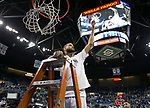 Nevada forward Caleb Martin (10) cuts down the nets after there win over San Diego State in an NCAA college basketball game in Reno, Nev., Saturday, Mar. 9, 2019. (AP Photo/Tom R. Smedes)
