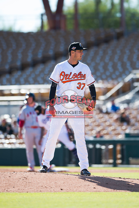 Glendale Desert Dogs relief pitcher Tanner Chleborad (37), of the Baltimore Orioles organization, looks in for the sign during an Arizona Fall League game against the Mesa Solar Sox at Camelback Ranch on November 12, 2018 in Glendale, Arizona. Glendale defeated Mesa 4-2. (Zachary Lucy/Four Seam Images)
