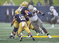 Annapolis, MD - September 8, 2018: Memphis Tigers defensive lineman John Tate IV (90) pursues Navy Midshipmen quarterback Malcolm Perry (10) while being blocked by Navy Midshipmen guard Steve Satchell (64) during game between Memphis and Navy at  Navy-Marine Corps Memorial Stadium in Annapolis, MD. (Photo by Phillip Peters/Media Images International)