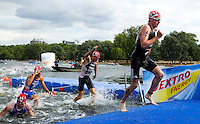 25 JUL 2010 - LONDON, GBR - Jonathan Brownlee prepares himself to re enter the water after completing the first swim lap at the mens race of the London round of the ITU World Championship Series triathlon (PHOTO (C) NIGEL FARROW)