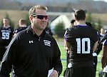 ROME, GA - DECEMBER 17: University of Sioux Falls Head Coach Jed Stugart monitors his team as they go through warm ups on the field Friday afternoon at Barron Stadium in Rome Ga. The Cougars play Carroll College Saturday afternoon for the NAIA National Championship. (photo by Dave Eggen/Inertia)