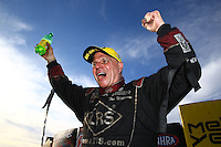 Feb 28, 2016; Chandler, AZ, USA; NHRA funny car driver Tim Wilkerson celebrates after winning the Carquest Nationals at Wild Horse Pass Motorsports Park. Mandatory Credit: Mark J. Rebilas-USA TODAY Sports