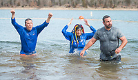 NWA Democrat-Gazette/BEN GOFF @NWABENGOFF<br /> Adam Steenken (from left), Misty Barnes and Ryan Veit with a group from Coldwell Banker Harris McHaney &amp; Faucette representing the Northwest Arkansas Board of Realtors take the plunge Saturday, Feb. 9, 2019, during the Special Olympics Arkansas Beaver Lake Polar Plunge at Prairie Creek recreation area. Divers measured the water temperature at 44 degrees Fahrenheit and the air temperature in nearby Rogers rose to 30 degrees Fahrenheit by the time participants dove in, according to the National Weather Service. The annual event is a fundraiser for Special Olympics Arkansas.