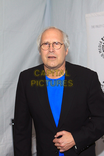 "CHEVY CHASE.27th Annual PaleyFest Presents ""Community""  held at the Saban Theatre, Beverly Hills California, USA,.3rd March 2010.arrivals half length blue t-shirt black jacket glasses hand blazer .CAP/ADM/TC.©T. Conrad/AdMedia/Capital Pictures."
