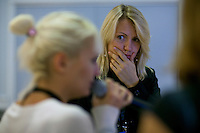 Moscow, Russia, 25/09/2010..A voice coach watches Russian competitor Sona Dilanyan rehearse the theme from the James Bond film Goldeneye at the finals of the Karaoke World Championships 2010, where amateur singers from around the world competed for prizes that included one million Russian dumplings...