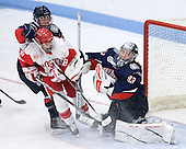 Jocelyn Slattery (UConn - 27), Louise Warren (BU - 28), Alexandra Garcia (UConn - 83) - The Boston University Terriers defeated the visiting University of Connecticut Huskies 4-2 on Saturday, November 19, 2011, at Walter Brown Arena in Boston, Massachusetts.