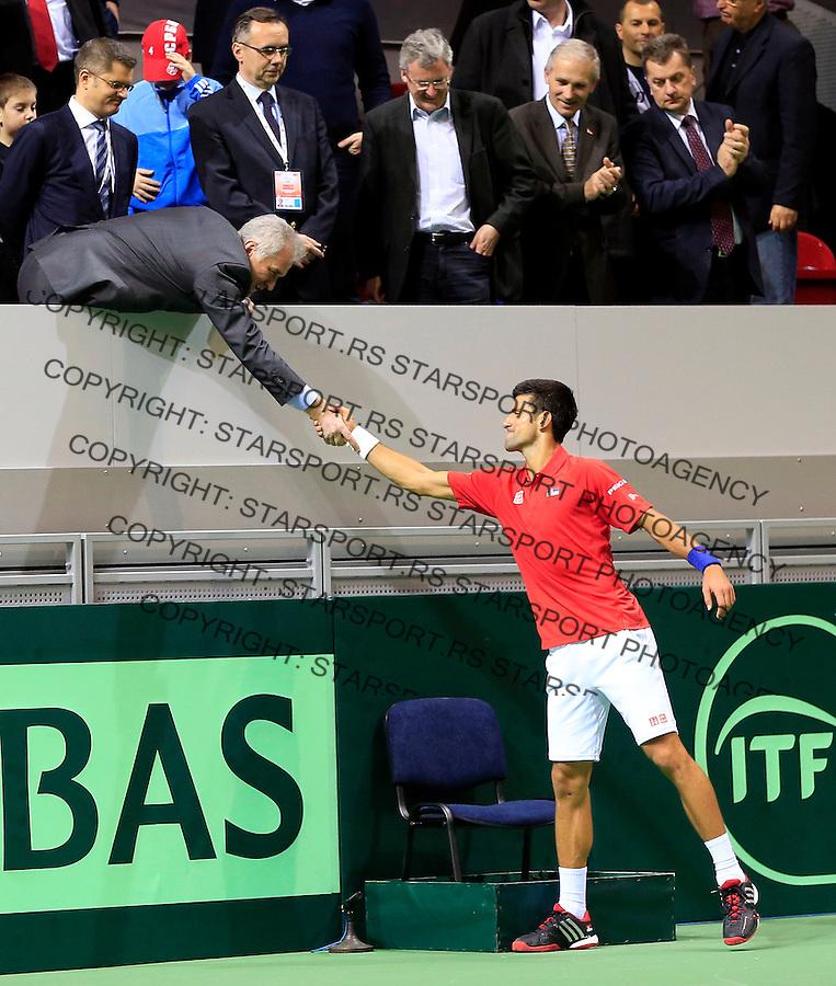 Davis Cup 2014 first round<br /> Srbija v Hrvatska<br /> Novak Djokovic (SRB) v Mate Delic (CRO)<br /> Novak Djokovic and Tomislav Nikolic (L)<br /> Kraljevo, 06.03.2015.<br /> Foto: Srdjan Stevanovic/Starsportphoto.com&copy;