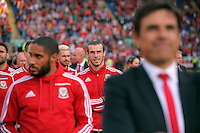 """Pictured L-R: Ashley Williams, Gareth Bale and Chris Coleman Friday 08 July 2016<br />Re: Thousands of fans are expected to line the streets to welcome back the Wales national team. An open top bus will parade through Cardiff, from Cardiff Castle to Cardiff City Stadium where the Manic Street Preachers will play to 33,000 people.<br />The parade comes after Wales lost 2-0 to Portugal in the semi-final on Wednesday, with their historic run hailed as a performance which has """"changed Welsh football forever""""."""