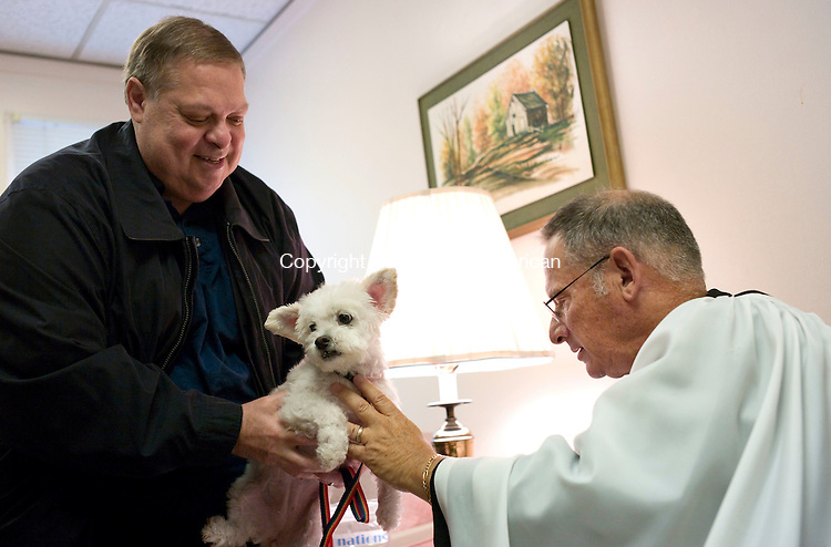 Middlebury, CT- 03 October 2015-100315CM04-  <br /> Steve Ferrucci of Middlebury has Molly a mixed breed blessed by The Reverend Andrew Zeman at St. George's Episcopal Church in Middlebury on Saturday.     Christopher Massa Republican-American