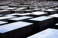 Germany, Berlin. Holocaust Memorial designed by Peter Eisenman.  An undulating field of concrete stele between the Reichstag and Potsdamer Platz.