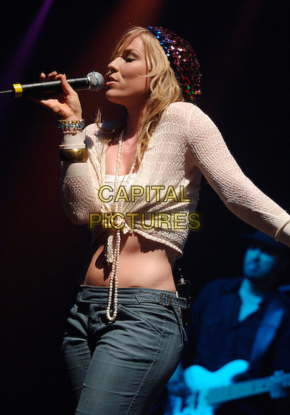 NATASHA BEDINGFIELD.V Festival 2005, Hylands Park.Chelmsford, Essex, England, UK.August 21st, 2005.virgin music live on-stage stage performing v-festival v2005 concert live gig performance half length sequin hat pearl necklace knotted tied white cardigan shrug belly stomach midriff singing.www.capitalpictures.com.sales@capitalpictures.com.©Capital Pictures