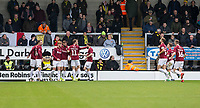 5th January 2020; Pirelli Stadium, Burton Upon Trent, Staffordshire, England; English FA Cup Football, Burton Albion versus Northampton Town; Ryan Watson of Northampton Town celebrates with his team after scoring in the 23rd minute 0-2 - Strictly Editorial Use Only. No use with unauthorized audio, video, data, fixture lists, club/league logos or 'live' services. Online in-match use limited to 120 images, no video emulation. No use in betting, games or single club/league/player publications
