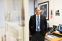 "Anthony Amore is the Directory of Security and Chief Investigator at the Isabella Stewart Gardner Museum in Boston, Mass., USA, seen here in his office on Tues., Dec. 5, 2017. Part of Amore's ongoing work is the investigation into the 1990 theft of 13 pieces from the museum: 10 paintings, 2 objects, and 1 etching. Among the paintings stolen were works by Rembrandt, Vermeer, Degas, and Manet. At right, hanging on the wall, is a reproduction of Vermeer's ""The Concert."" The painting is one of those stolen in the heist."