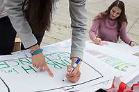 Harvard junior Lexi Smith (right), 20, makes a sign before the March for Science demonstration in Harvard University's Science Center Plaza in Cambridge, Massachusetts, on Sat., April 22, 2017. Smith studies Environmental Science and Public Policy and is part of a student group called the Environmental Action Committee.