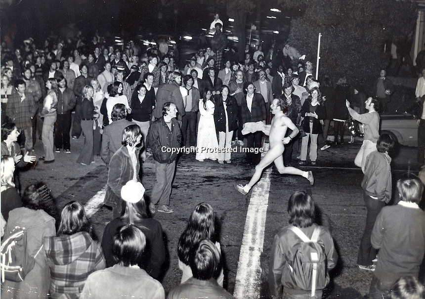 Streaking craze hits University of California. Crowd at the corner of Channing Way & College Ave cheer as a student streaker passes. Photo COPYRIGHT 1974 by Ron Riesterer