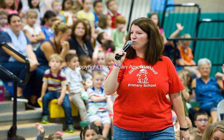 WATERTOWN, CT-091517JS01-- Shannon E. MeDonnell, reading specialist at John Trumbull Primary School in Waterbury, announces the total number of book read during the Summer Reading Program during an assembly Friday at the school. The event was held as a promise to the students if they broke last years number of books read as part of the Summer Reading Program. The students read 8261 books, beating last years total by nearly 1000 books.<br /> Jim Shannon Republican-American